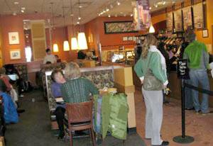 Lunctime customers crowd the counter at Panera.