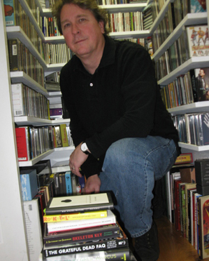 Steve Jurgensmeyer lost among his CDs.