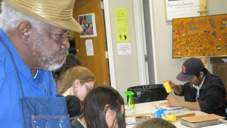 Winfred Rembert observing art class at AHS.